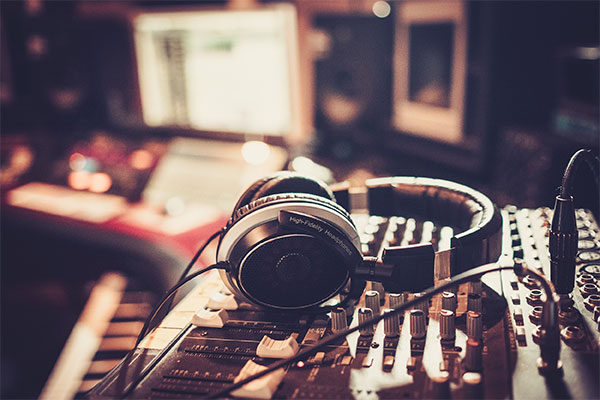 Image of headphones in music recording studio